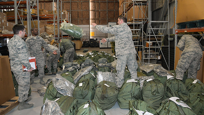 Airmen pick up mobility bags during Exercise Razor Blade 18-02